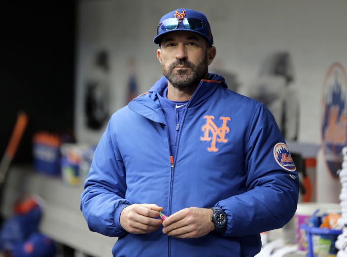 "FILE - In this Sunday, April 28, 2019, file photo, then-New York Mets manager Mickey Callaway stands by the dugout before a baseball game against the Milwaukee Brewers at Citi Field, in New York. Callaway, former manager of the New York Mets and current Los Angeles Angels pitching coach, ""aggressively pursued"" several women who work in sports media and sent three of them inappropriate photos, The Athletic reported Monday, Feb. 1, 2021. (AP Photo/Seth Wenig, File)"