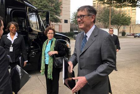 FILE PHOTO: Federal Reserve Vice Chairman Clarida boards a bus to tour South Dallas as part of a community outreach by U.S. central bankers in Dallas