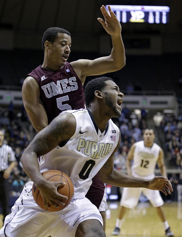 Purdue guard Terone Johnson is hit by Maryland-Eastern Shore guard Louis Bell as he drives the baseline in the first half of an NCAA college basketball game in West Lafayette, Ind., Tuesday, Dec. 17, 2013. (AP Photo/Michael Conroy)