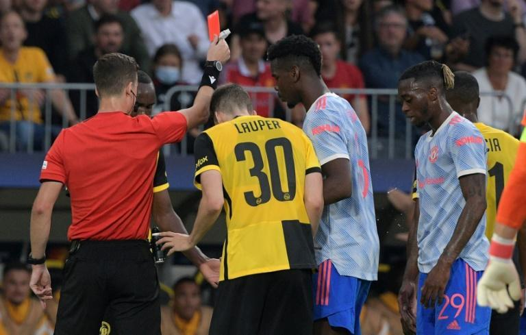 Aaron Wan-Bissaka was shown a straight red card for a dangerous challenge on Christopher Martins (AFP/SEBASTIEN BOZON)