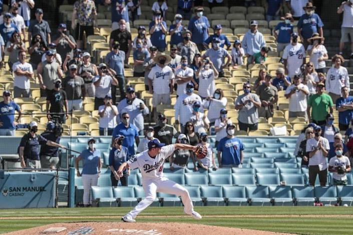 Dodgers reliever Corey Knebel delivers the final pitch of the game as he saves a 1-0 win over the Nationals on April 9, 2021.