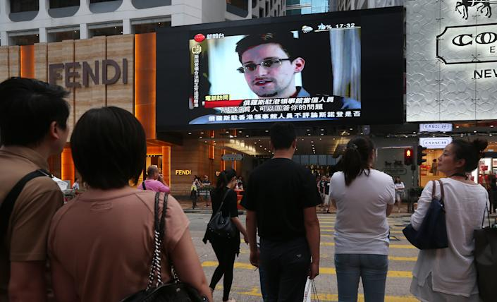 U.S. whistle-blower Edward Snowden is displayed on a giant screen during a local news program in Hong Kong, China on June 23, 2013. The Hong Kong government has confirmed that Edward Snowden has left Hong Kong and is on a commercial flight to Russia. (Sam Tsang/South China Morning Post via Getty Images)
