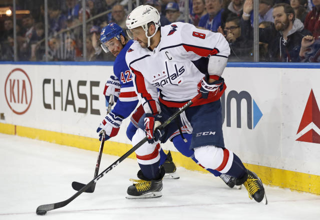 Washington Capitals left wing Alex Ovechkin (8) maneuvers the puck in front of New York Rangers defenseman Brendan Smith (42) during the first period of an NHL hockey game Thursday, March 5, 2020, in New York. (AP Photo/Kathy Willens)