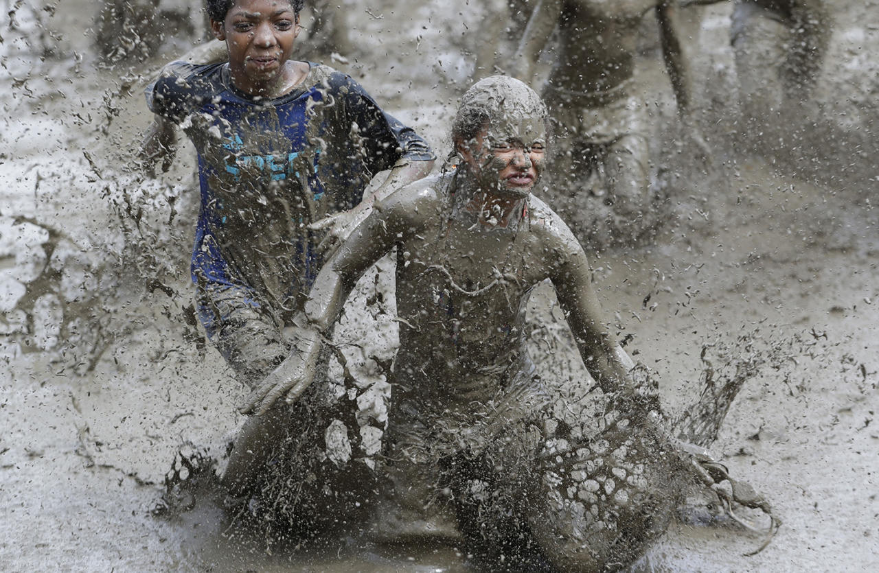 <p>Kids participate in races during Mud Day at the Nankin Mills Park, July 11, 2017 in Westland, Mich. (Photo: Carlos Osorio/AP) </p>