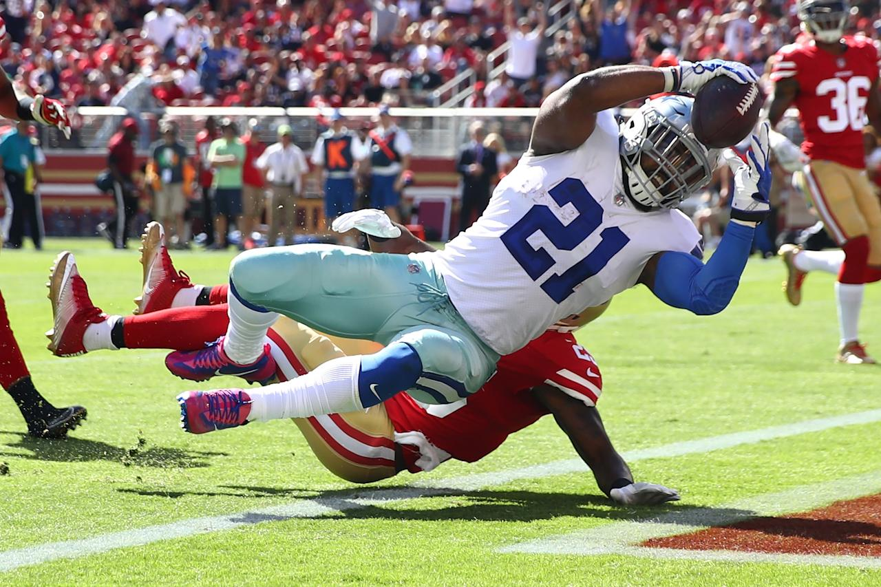 <p>Ezekiel Elliott #21 of the Dallas Cowboys scores his second touchdown against the San Francisco 49ers during their NFL game at Levi's Stadium on October 22, 2017 in Santa Clara, California. (Photo by Ezra Shaw/Getty Images) </p>