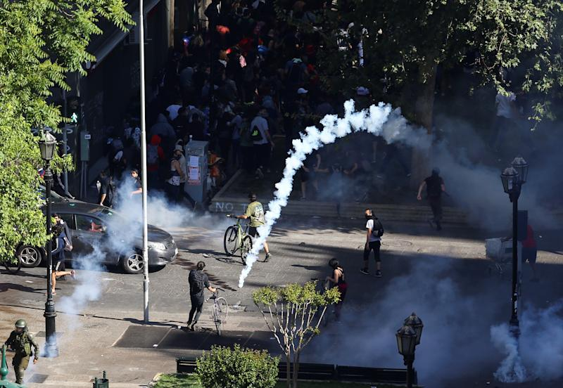 People is dispersed with tear gas during a protest against Chile's government in Santiago, Chile on Oct. 28, 2019. (Photo: Ivan Alvarado/Reuters)