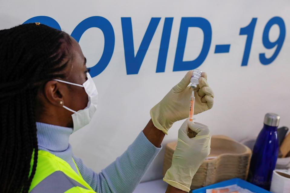 A dose of AstraZeneca vaccine is prepared at A COVID-19 vaccination centre in the Odeon Luxe Cinema in Maidstone. Photo: Andrew Couldridge/Reuters