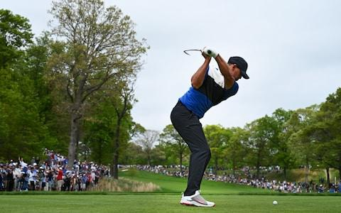 Brooks Koepka hits from the 2nd tee - Credit: Getty Images North America