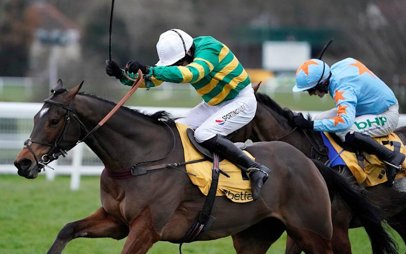Barry Geraghty riding Defi Du Seuil (green) clears the last to win at Sandown - Getty Images Europe