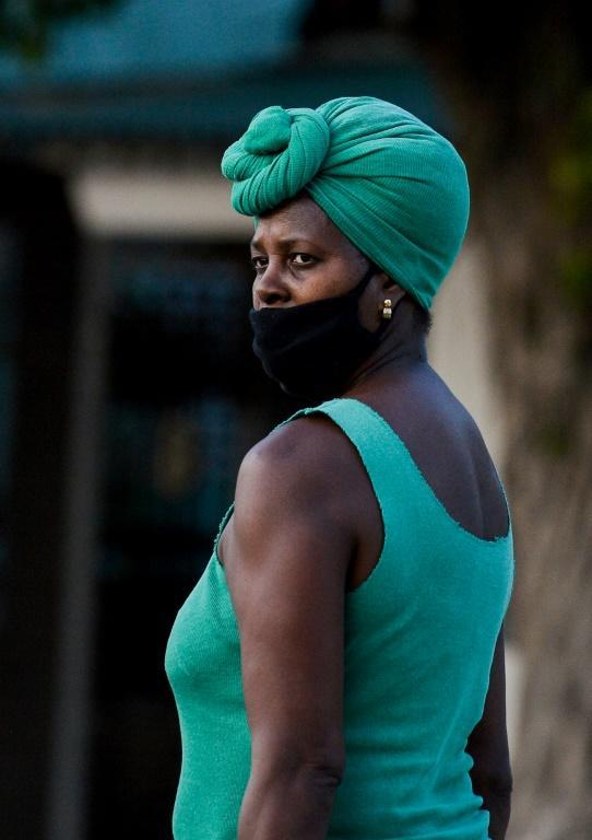 A significantly lower proportion of black people than whites in Cuba own a bank account or have traveled abroad (AFP Photo/Yamil LAGE)