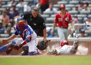 Cincinnati Reds Josh VanMeter (17) slides into home to score as Atlanta Braves catcher Tyler Flowers (25) is late with the tag in the fifth inning of a baseball game, Sunday, Aug. 4, 2019, in Atlanta. (AP Photo/Todd Kirkland)