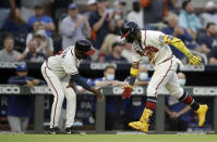 Atlanta Braves' Ronald Acuna Jr., right, celebrates with third base coach Ron Washington after hitting a home run off Toronto Blue Jays pitcher Robbie Ray in the third inning of a baseball game Tuesday, May 11, 2021, in Atlanta. (AP Photo/Ben Margot)