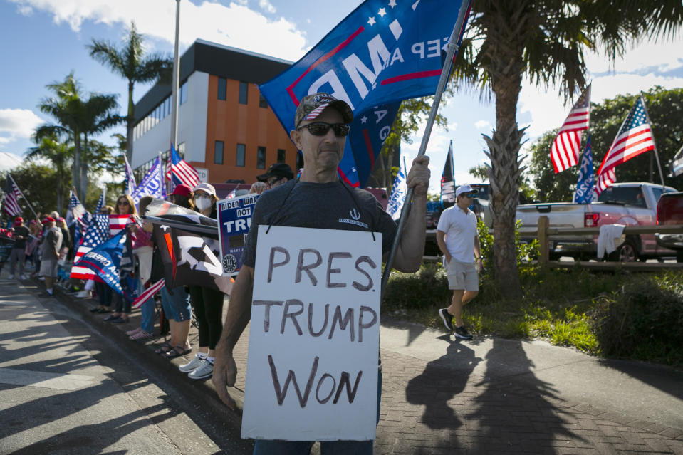 US President Donald Trump supporters wait for the motorcade to pass by on their way to Mar-a-Lago in Palm Beach, Florida, on January 20, 2021. (Photo by Eva Marie UZCATEGUI / AFP) (Photo by EVA MARIE UZCATEGUI/AFP via Getty Images)