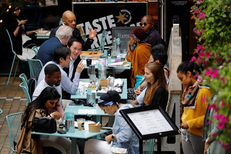 Diners eating al fresco at restaurants in the capital (AFP via Getty Images)