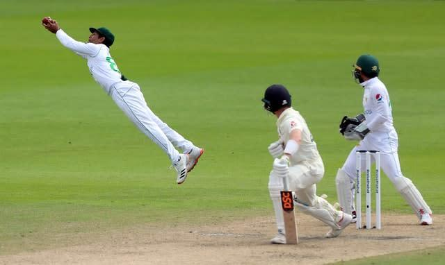 Dom Bess falls to a brilliant catch by Asad Shafiq, left (Lee Smith/PA)