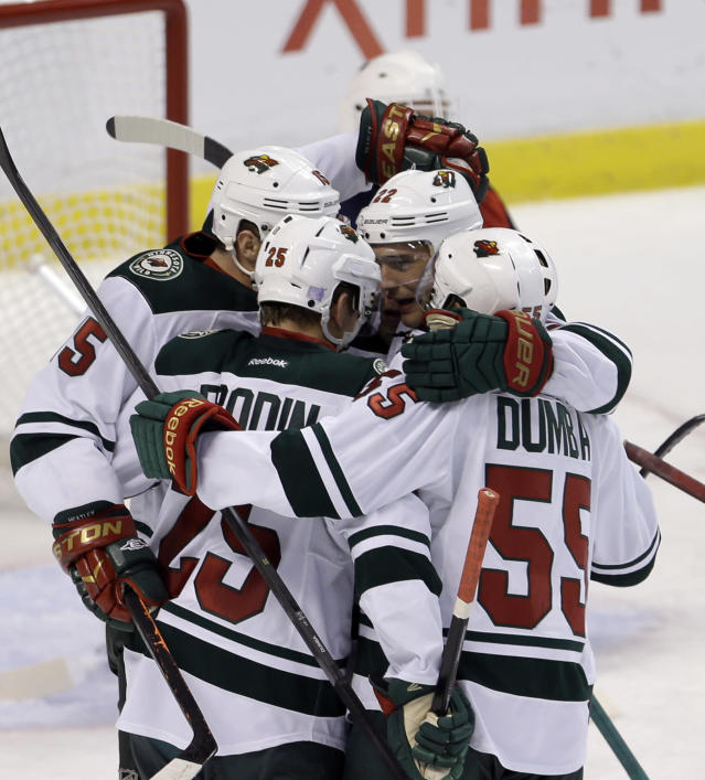 Minnesota Wild defenseman Jonas Brodin (25) is congratulated by teammates after scoring a goal against the Florida Panthers in the second period of an NHL hockey game, Saturday, Oct. 19, 2013, in Sunrise, Fla. (AP Photo/Alan Diaz)