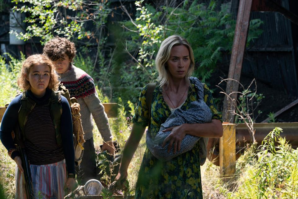 """Regan (Millicent Simmonds, left), Marcus (Noah Jupe) and Evelyn (Emily Blunt) try to stay silent and evade monsters in horror sequel """"A Quiet Place Part II."""""""