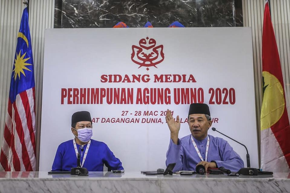 Umno deputy president Datuk Seri Mohamad Hassan (right) speaks during a press conference at the 2020 Umno annual general meeting in Kuala Lumpur March 27, 2021. ― Picture by Hari Anggara
