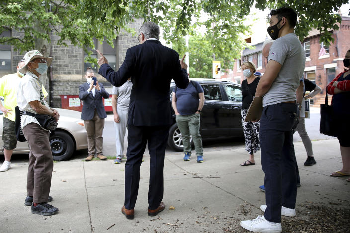 District attorney Larry Krasner, center, talks to volunteers before they canvas around the Fairmount neighborhood in Philadelphia, on Sunday, May 16, 2021. Voters will cast ballots Tuesday, May 18 in the Democratic Primary for Philadelphia District Attorney that pits reform-minded incumbent Krasner against veteran homicide prosecutor Carlos Vega, likely deciding the future of the office in the overwhelmingly Democratic city. (David Maialetti/The Philadelphia Inquirer via AP)