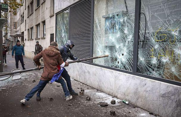 PHOTO: Black Bloc and Gilets Jaunes, or yellow vest protestors vandalize a branch of HSBC in Place d'Italie as protests turn violent with thousands of protesters converging on the French capital. (Kiran Ridley/Getty Images)
