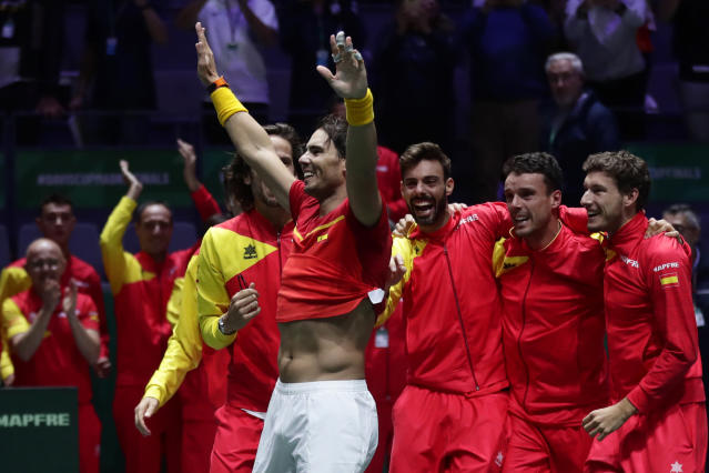 Spain's Rafael Nadal celebrates with his teammates after defeating Canada's Denis Shapovalov in their tennis singles match to win the Davis Cup final in Madrid, Spain, Sunday, Nov. 24, 2019. (AP Photo/Manu Fernandez)