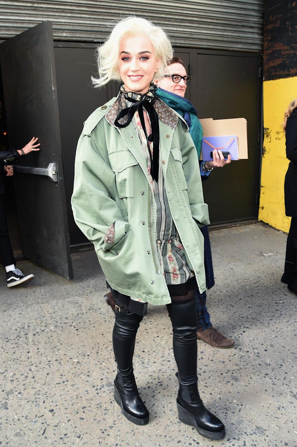<p>Katy Perry was casually dressed in a parka and platform thigh highs. <i>[Photo: Getty]</i> </p>