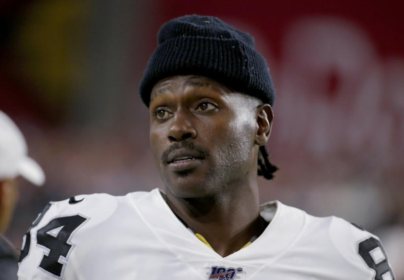 FILE - In this Aug. 15, 2019, file photo, Oakland Raiders wide receiver Antonio Brown watches from the sidelines during the second half of the team's NFL preseason football game against the Arizona Cardinals in Glendale, Ariz. Brown, who was released by the Raiders last week and is now with the New England Patriots, has been accused of rape by a former trainer. Britney Taylor says Brown sexually assaulted her on three occasions, according to a lawsuit filed Tuesday, Sept. 10, in the Southern District of Florida. Brown has denied the allegations (AP Photo/Rick Scuteri, File)