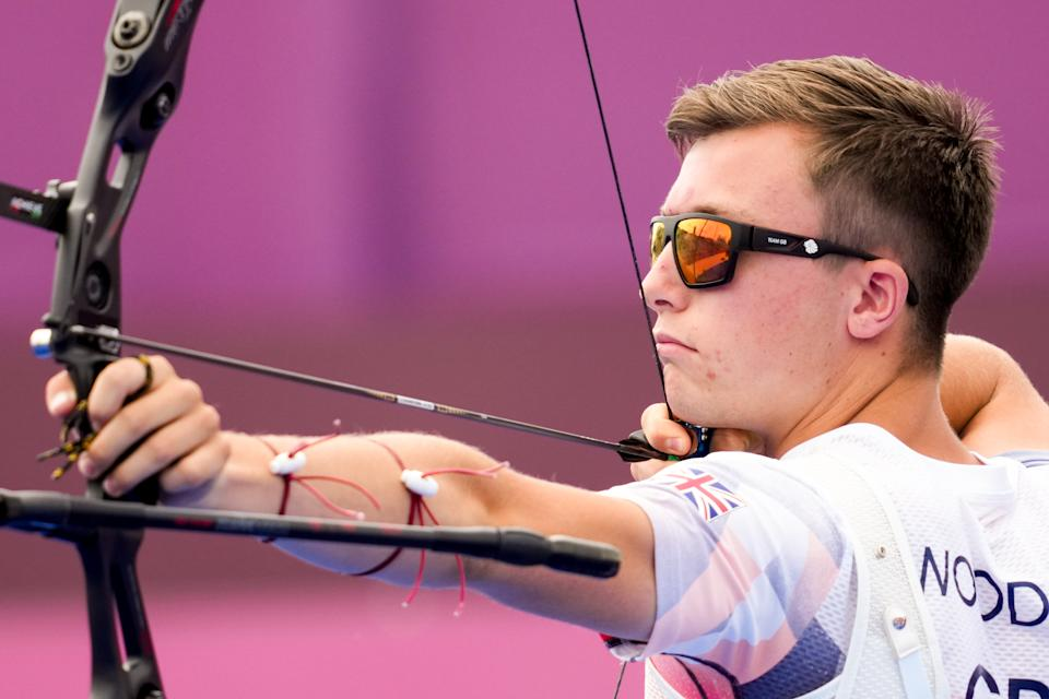 Olympic debutant Woodgate, 19, navigated his way to the last 64 but was unable to hit the target against Kazakh archer Ilfat Abdullin