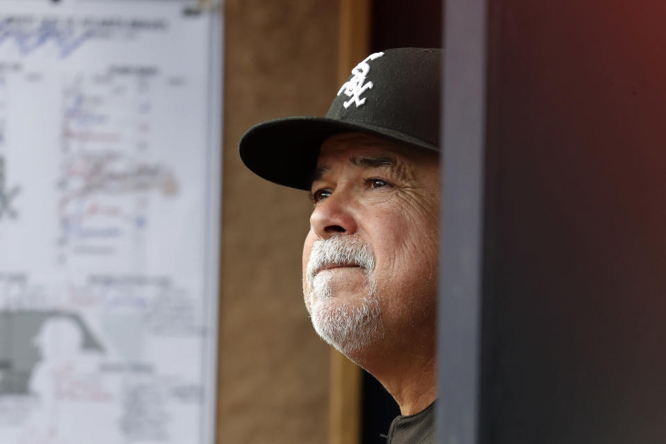 Chicago White Sox manager Rick Renteria (36) watches from the dugout during a baseball game against the Atlanta Braves Sunday, Sept. 1, 2019, in Atlanta. (AP Photo/John Bazemore)