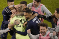 Sporting Kansas City players celebrate after winning an MLS soccer match against the San Jose Earthquakes with a penalty kick in overtime Sunday, Nov. 22, 2020, in Kansas City, Kan. (AP Photo/Charlie Riedel)