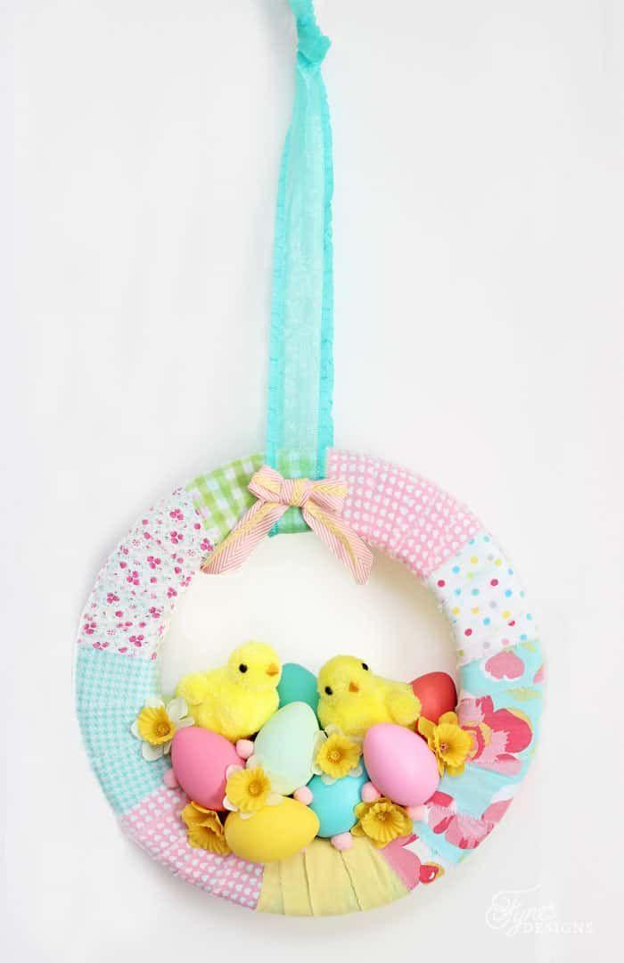 """<p>It looks like a couple baby chicks have flown the coop! Taking center stage, two fuzzy chicks are surrounded by flowers and eggs in this sweet wreath perfect for a nursery.</p><p><strong>Get the tutorial at <a href=""""https://www.fynesdesigns.com/easter-chick-spring-wreath/"""" rel=""""nofollow noopener"""" target=""""_blank"""" data-ylk=""""slk:Fynes Designs"""" class=""""link rapid-noclick-resp"""">Fynes Designs</a>.</strong></p><p><a class=""""link rapid-noclick-resp"""" href=""""https://go.redirectingat.com?id=74968X1596630&url=https%3A%2F%2Fwww.walmart.com%2Fip%2FDavid-Textiles-Cotton-Fabric-Antique-Rose-Collection-44-Inches%2F843379041&sref=https%3A%2F%2Fwww.thepioneerwoman.com%2Fhome-lifestyle%2Fcrafts-diy%2Fg35698457%2Fdiy-easter-wreath-ideas%2F"""" rel=""""nofollow noopener"""" target=""""_blank"""" data-ylk=""""slk:SHOP FABRIC"""">SHOP FABRIC</a></p>"""