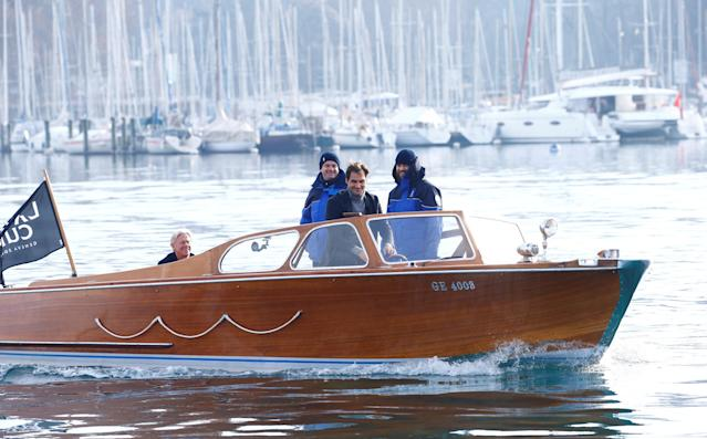 REFILE - ADDING DROPPED LETTER Bjorn Borg of Sweden (L) and two Swiss policemen are aboard as Switzerland's Roger Federer (2nd R) steers a boat during a promotion event for the Laver Cup tennis tournament on Lake Geneva in Geneva, Switzerland February 8, 2019. REUTERS/Arnd Wiegmann
