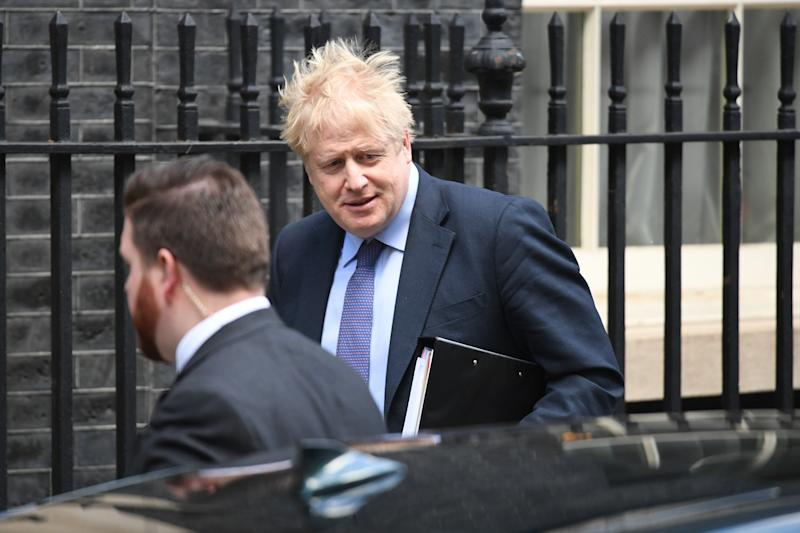 Boris Johnson leaves 10 Downing Street, London, for the House of Commons for Prime Minister's Questions.