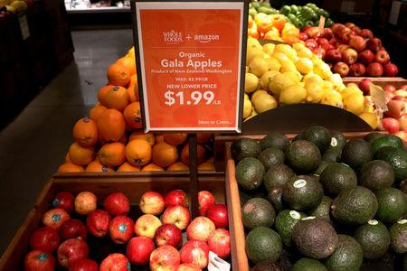 FILE PHOTO: Apples and avocados are displayed at a Whole Foods store in New York