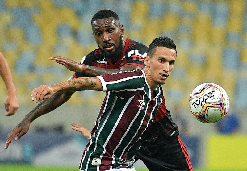 Flamengo's Gerson vies with Fluminenses's Dodi during their Rio de Janeiro state championship football match at Maracana football stadium, Rio de Janeiro on July 8, 2020. (Photo by CARL DE SOUZA / AFP) (Photo by CARL DE SOUZA/AFP via Getty Images)