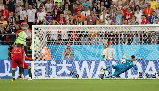 Soccer Football - World Cup - Group B - Iran vs Portugal - Mordovia Arena, Saransk, Russia - June 25, 2018 Iran's Alireza Beiranvand saves a penalty from Portugal's Cristiano Ronaldo REUTERS/Ricardo Moraes