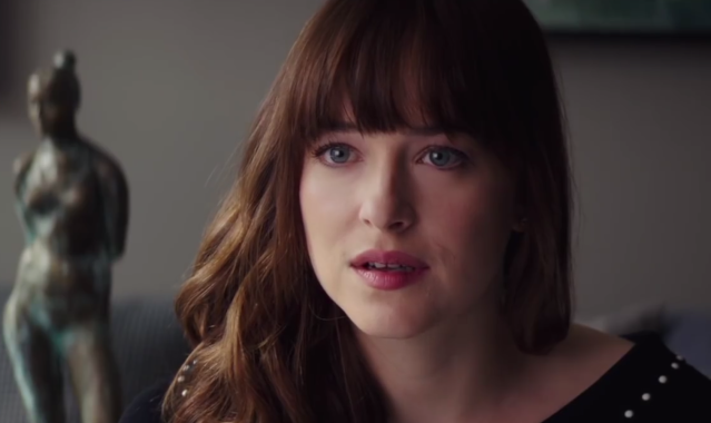 Ana (Dakota Johnson) learns she's pregnant in <em>Fifty Shades Freed</em>. (Photo: Universal)