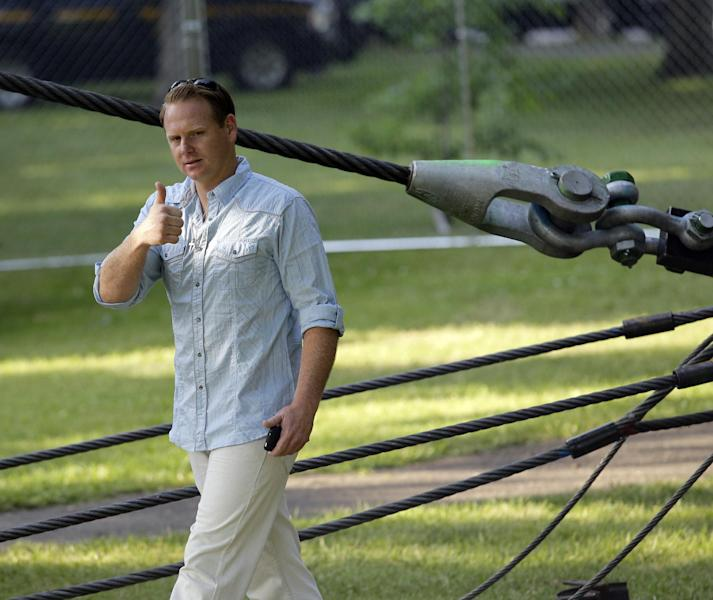 Nik Wallenda greets fans after inspecting the wire prior to his walk across Niagara Falls in Niagara Falls, N.Y., Friday, June 15, 2012. Wallenda will attempt what nobody has done before: A high wire walk directly over the precipice at Niagara Falls and 190 feet (58 meters) above the churning torrent below. (AP Photo/David Duprey)