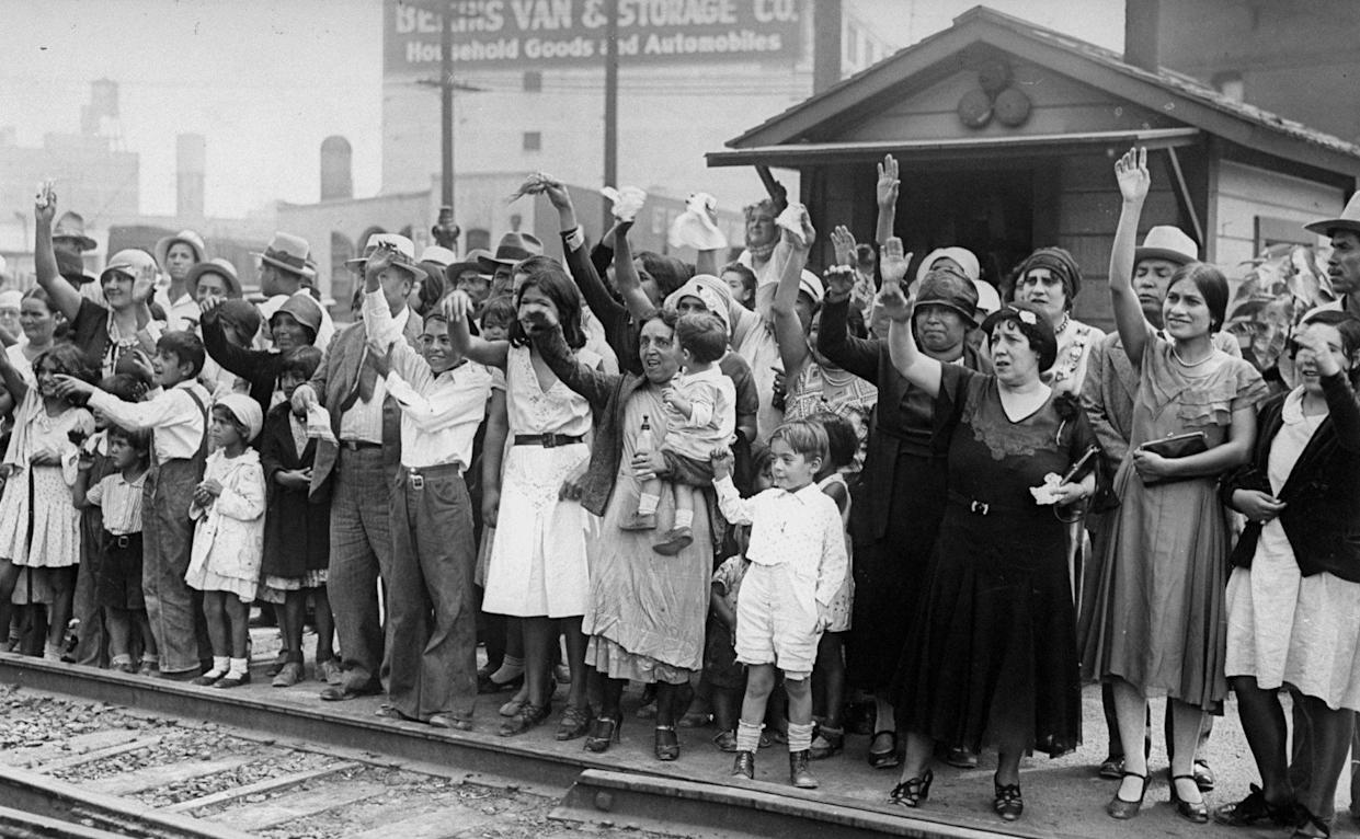 Relatives and friends wave goodbye to a train carrying 1,500 illegal Mexicans being deported from Los Angeles to Mexico in 1931. (Photo: NY Daily News Archive via Getty Images)