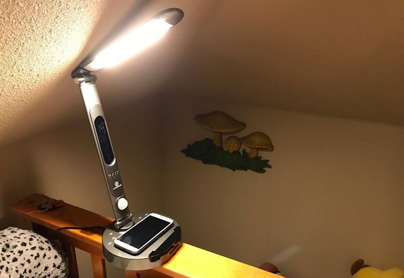 A LumiCharge smart lamp lights up the room it's in while charging an iPhone.
