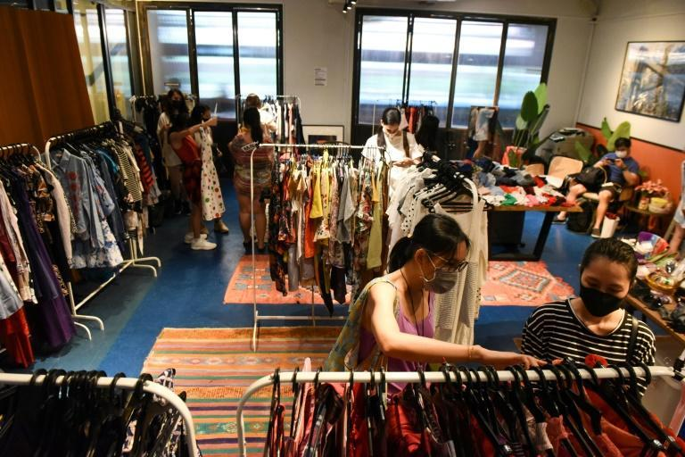 Shoppers browse second-hand clothes at a pop-up swap event organised by a group of volunteers in Singapore