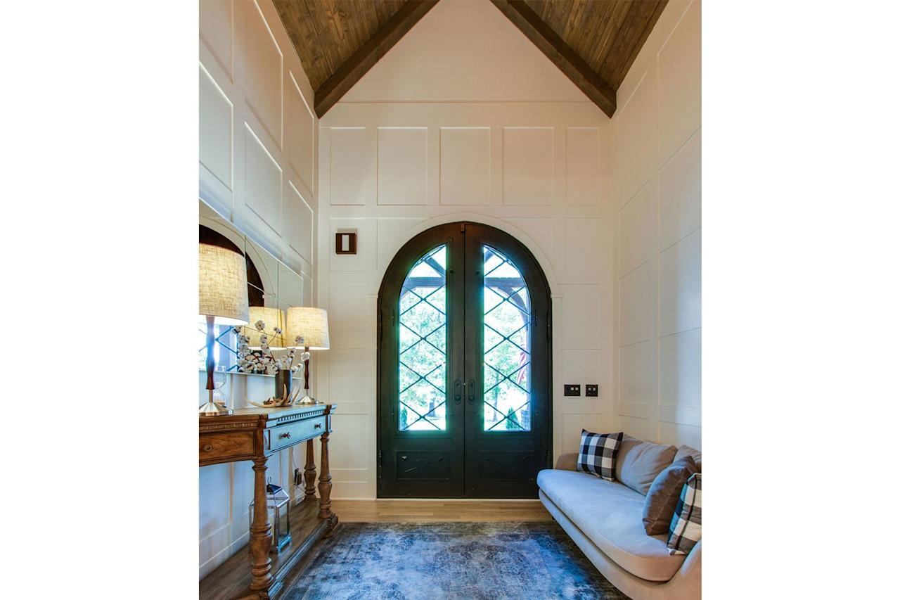 <p>Cathedral ceilings and a green arched door are grand indeed.</p>
