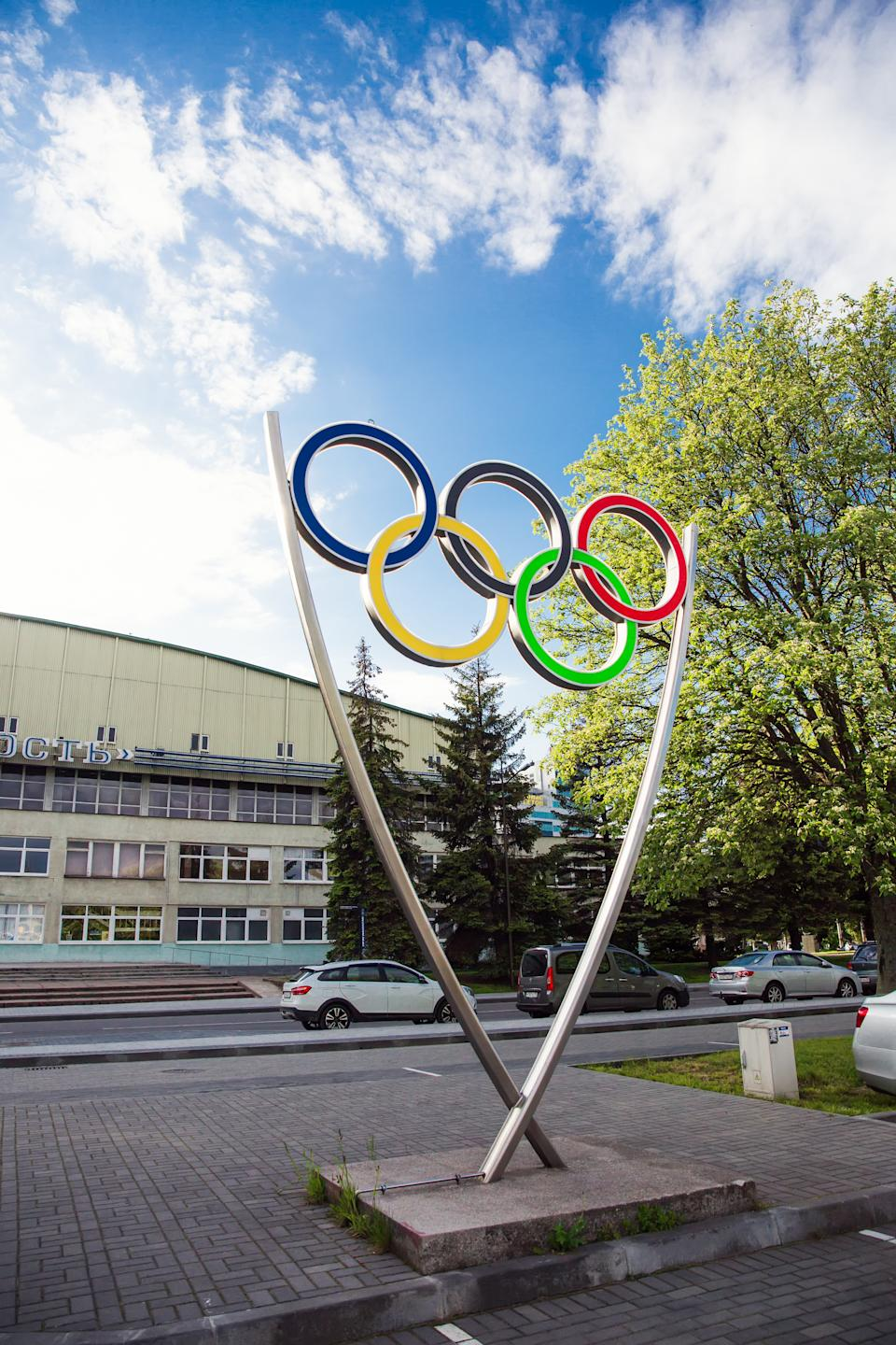 Sign of Olympic rings, symbol of Olympics in urban environment.