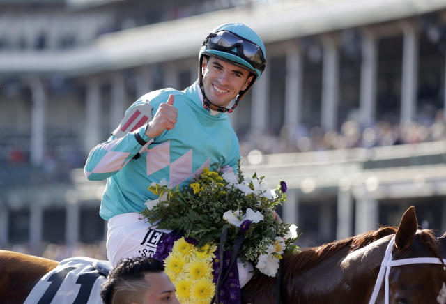 Florent Geroux celebrates after riding Monomoy Girl to victory in the Breeders' Cup Distaff horse race at Churchill Downs, Saturday, Nov. 3, 2018, in Louisville, Ky. (AP Photo/Darron Cummings)