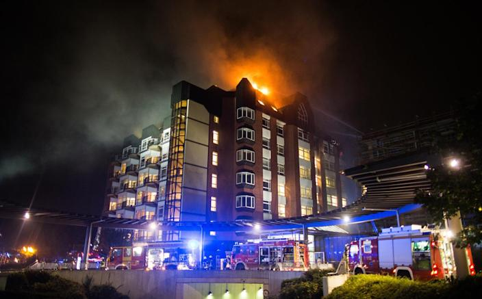 <p>A general view shows firefighters arriving at the scene of a fire burning the upper floors of the Bergmannsheil hospital in Bochum, Germany, Sept. 30, 2016. According to the fire department, two people were killed in the firefight and at least 15 others were injured. (Photo: MARCEL KUSCH/EPA)</p>