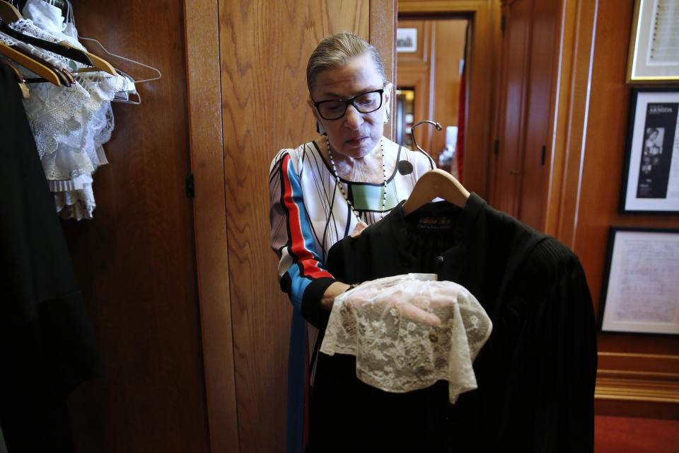 Ginsburg showing the collar she wears with her robes in courtroom sessions, in her chambers at the Supreme Court. (Photo: Jonathan Ernst/Reuters)