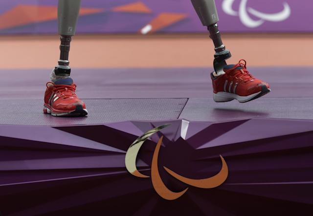 Britain's Richard Whitehead waits for the medal ceremony after winning the men's 200m T42 final race at the 2012 Paralympics in London, Saturday, Sept. 1, 2012. (AP Photo/Lefteris Pitarakis)