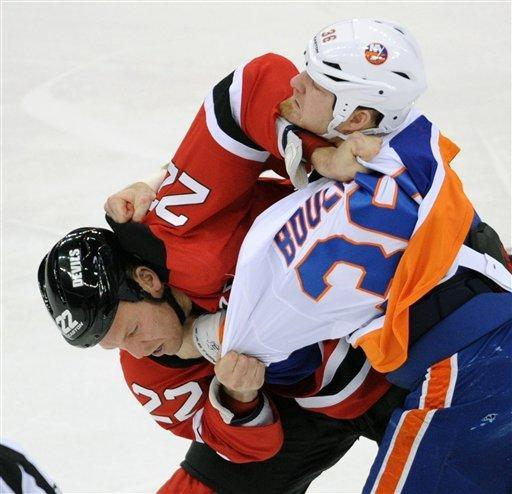 New Jersey Devils' Krystofer Barch, left, and New York Islanders' Eric Boulton fight during the first period of an NHL hockey game Thursday, Jan. 31, 2013, in Newark, N.J. (AP Photo/Bill Kostroun)