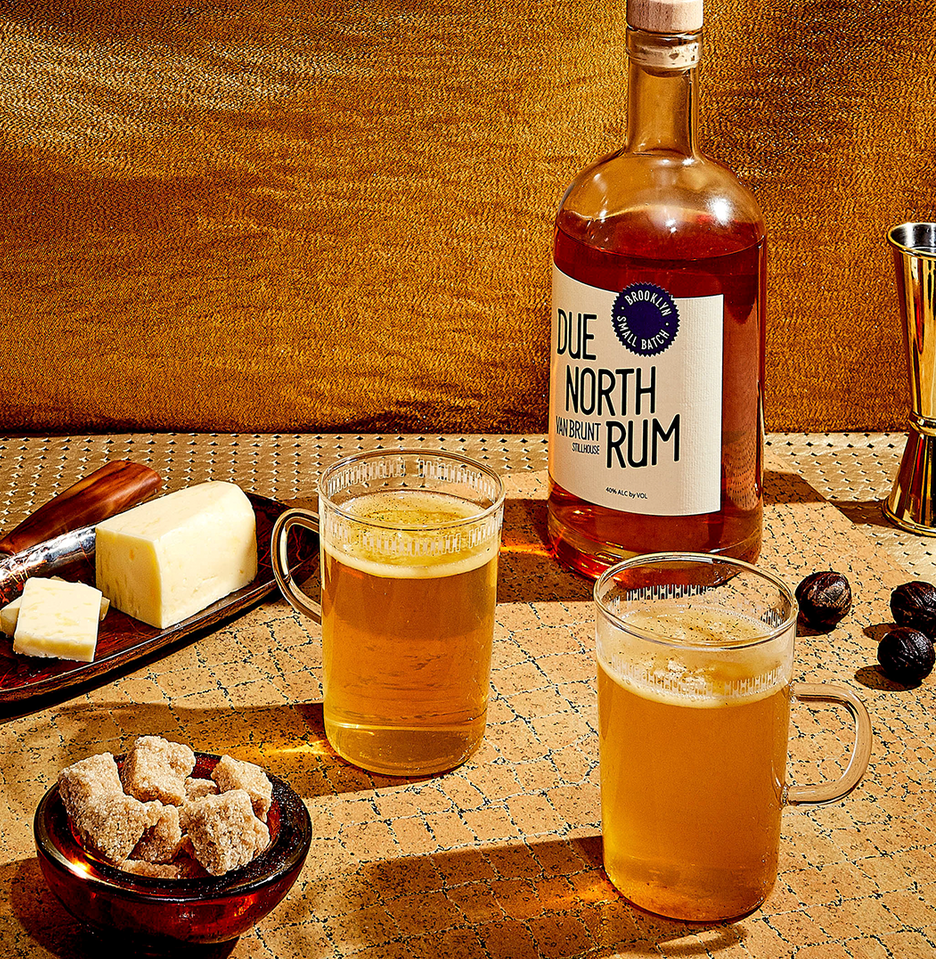 """<p><em>It's like taking tea to quiet the stomach and soothe the soul. Only, of course, rum makes it better.</em></p><p><strong>Ingredients</strong></p><p>• 2 oz. dark rum<br>• 2 sugar cubes<br>• 1 pat unsalted butter </p><p><strong>Directions</strong></p><p>In a mug, dissolve the sugar cubes in a little hot water. Add rum and butter. Fill the mug with hot water. Sprinkle nutmeg on top.</p><p><a class=""""link rapid-noclick-resp"""" href=""""https://www.esquire.com/food-drink/drinks/recipes/a3798/hot-buttered-rum-drink-recipe/"""" rel=""""nofollow noopener"""" target=""""_blank"""" data-ylk=""""slk:Read More"""">Read More</a></p>"""