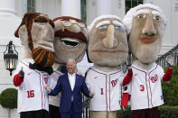 President Joe Biden visits with members of the Washington Nationals' Racing Presidents after speaking at an Independence Day celebration on the South Lawn of the White House, Sunday, July 4, 2021, in Washington. (AP Photo/Patrick Semansky)